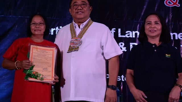 Deceased farmer's daughter receives land title