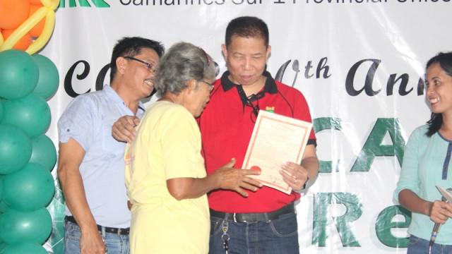 DAR distributes land titles to 310 farmers in Camarines Sur