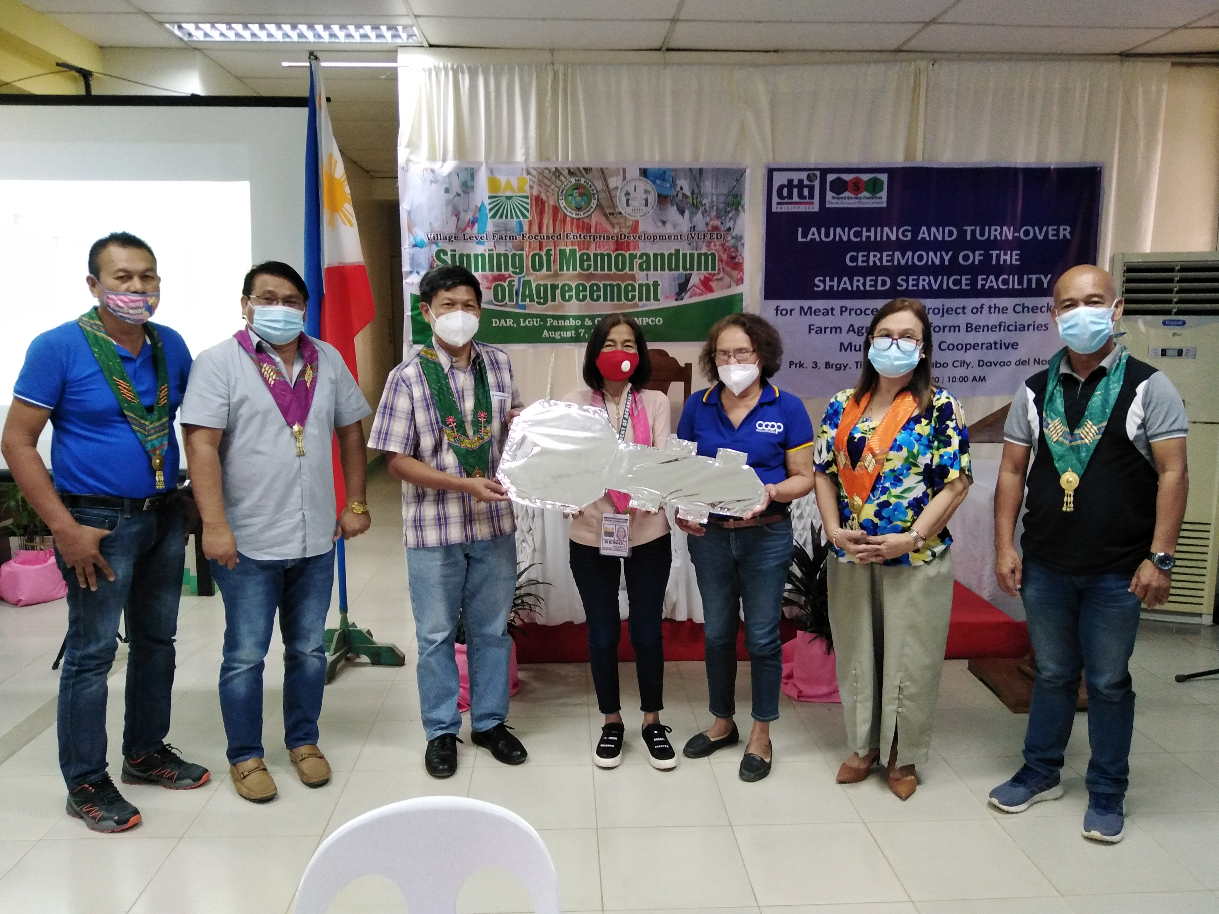 The ceremonial turn-over of key of responsibility of the P 1 Million worth of Meat Processing Plant in CFARBEMPCO, Panabo City. From left  Tibungol, Panabo City Brgy. Captain Fernando Candol, Panabo City Mayor Jose Relampagos, DTI Provincial Director Romeo Castanaga, PARPO Jocelyn Seno, CFARBEMCO Chairperson Eleuteria Chacon, DTI Asst. Regional Director Marie Ann How and City Councilor Emeterio Blase